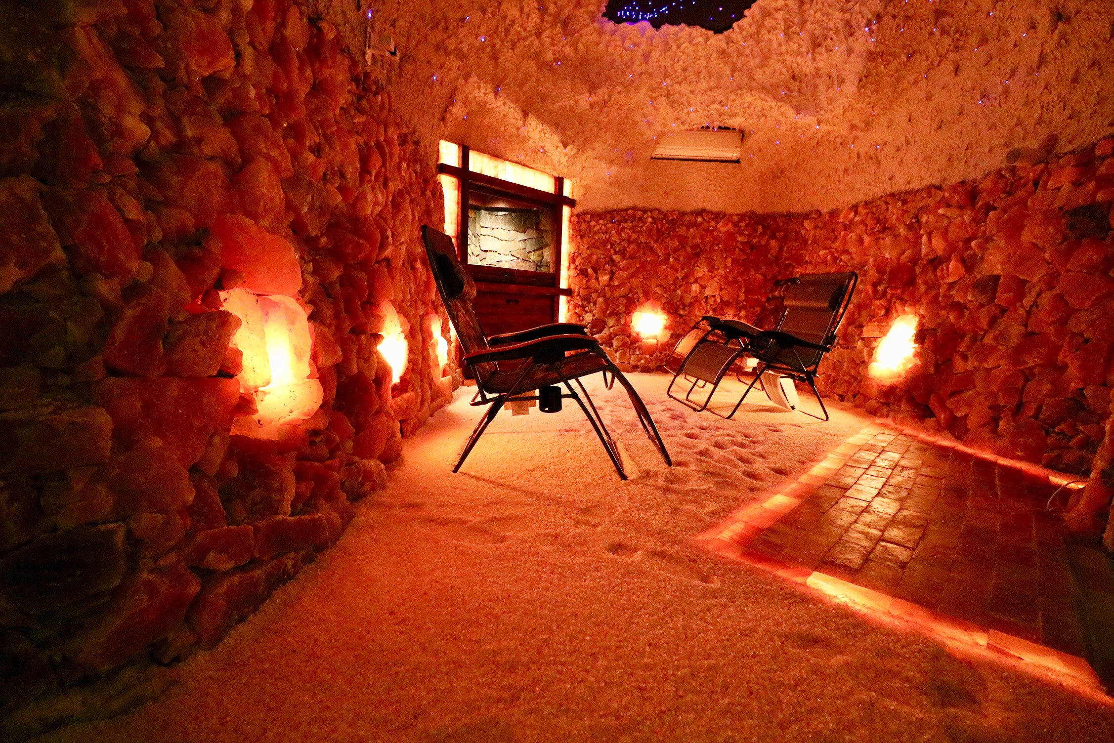The salt room spa contains a temperature and humidity controlled atmosphere of ionized air (negatively charged ions) that is anti-bacterial, anti-viral, and microbe-free