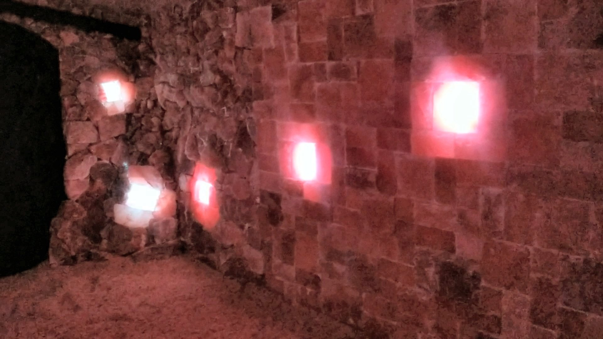 Salt Wall: a brick and tile mix with sporadic backlighting