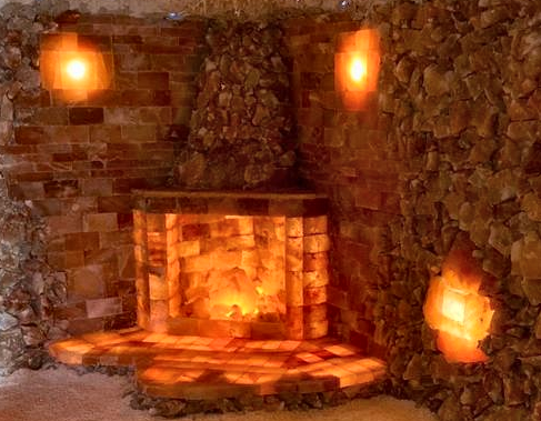 The fireplace with chimney stack add-on is a brilliant eye-catching center piece for any salt room
